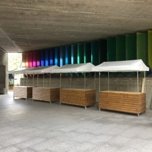 Four empty wooden food carts for hire at big kahuna