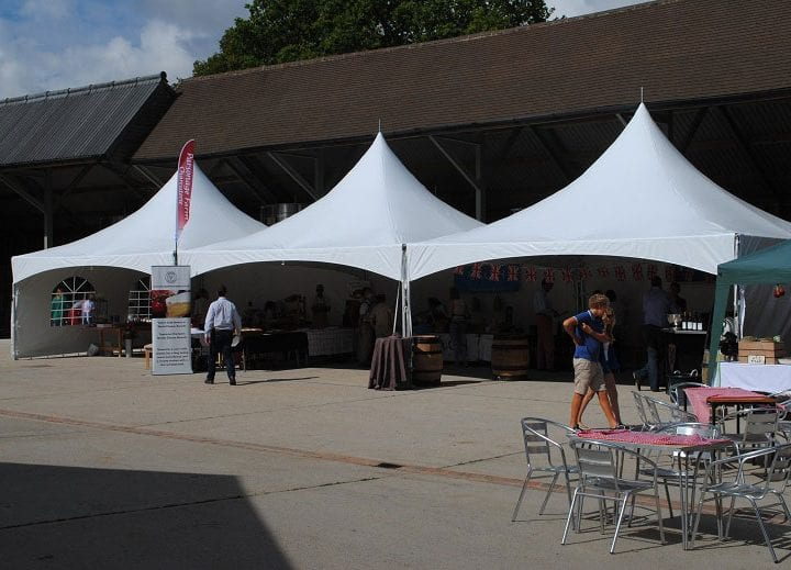 Three White 6m Pagoda Marquee Stands at an event